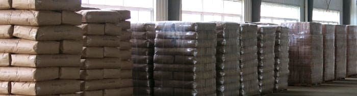 A warehouse with pallets of neatly arranged specialty bulk tea.